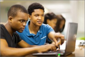 African College Students Using a Laptop Together